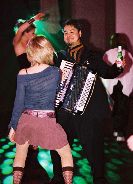 Photo: The Best Accordion Picture Ever! Joey deVilla dances with a comely young lass, who's obviously taken with the accordion.