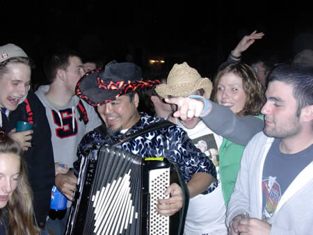 Photo: Me playing accordion for the students at the Crazy Go Nuts University homecoming street party.