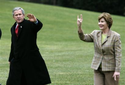 Photo: Laura Bush throws the horns!