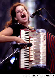 Photo: Regine Chassagne from The Arcade Fire playing accordion.