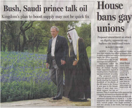 Photo: Newspaper showing photo of George Bush and Prince Bandar holding hands beside a story titled 'House to ban gay unions'.