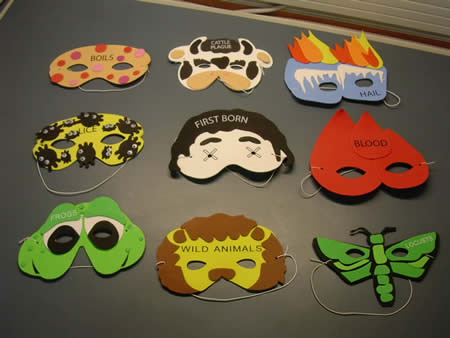 Photo: Masks depicting the plagues visited upon Egypt.