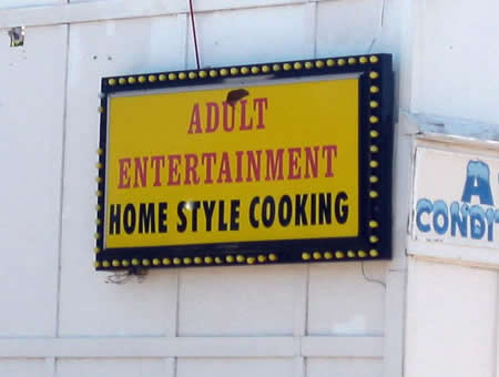 Photo: Sign that reads 'Adult Entertainment / Home Style Cooking'.