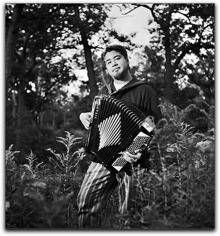 Photo: Joey deVilla poses with his accordion in High Park for one of Rannie Turingan's 'Portraits in the Park'.