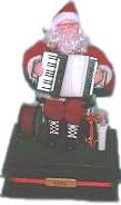 Photo: Figurine of Santa playing the accordion.